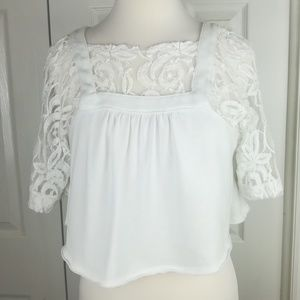 Free People white crop top with lace sleeves